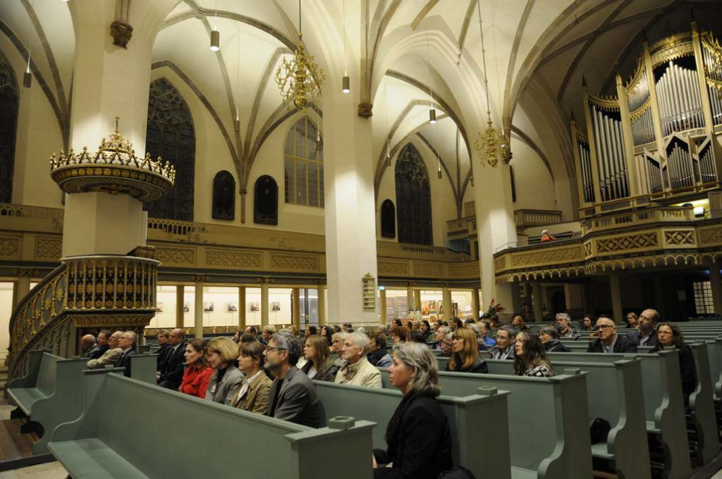 Publikum der ERöffnungsfeier im Vorfeld des Restauarorentags in der Stadtkirche Wittenberg. Foto: Gudrun von Schoenebeck.
